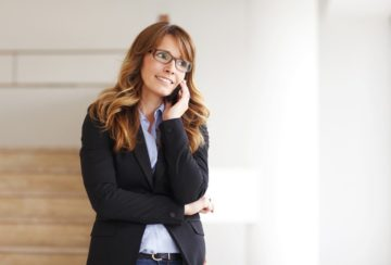 Smiling professional businesswoman on the phone